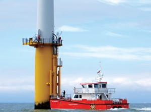 The 72' NSL Discovery, seen here transporting workers to a turbine in the Thanet Offshore Wind Farm, helps put the enormous size of these structures into perspective.   (Lorelei Stevens photo)