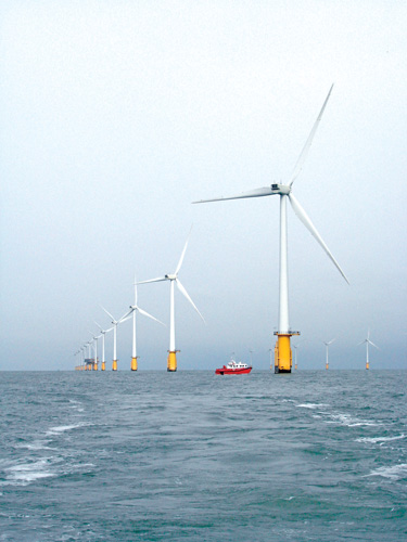 The 72' NSL Discovery navigates through the Thanet Offshore Wind Farm turbines.  All together, the turbines have a maximum capacity to generate 300 megawatts of electricity, enough to meet the energy needs of 200,000 UK households, according to project developer Vattenfall.  (John Williamson photo)