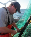Phil Ruhle Jr. of Point Judith, RI aboard his Sea Breeze Too, working on CFRF's drop chain conservation gear engineering project to reduce flounder bycatch in small-mesh fisheries. (CFRF photo)