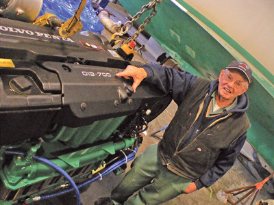 """This one's only 700 horses,"" says Andy, pointing to the tag on his new D13 Volvo Penta. (Brian Robbins photo)"