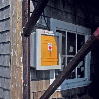 Know what you are looking for.  These watertight boxes found on a number of Maine wharves can safe a life – your's or a fellow fisherman's. (Ann Backus photo )