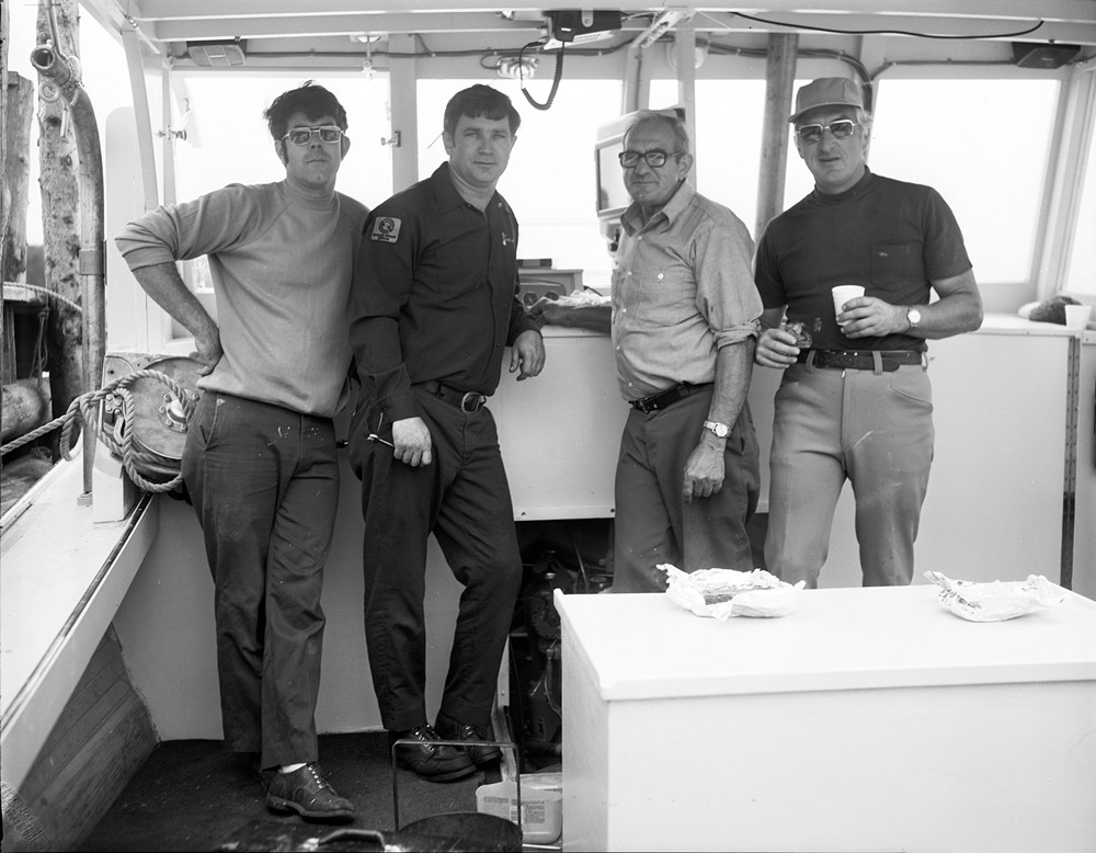 From 1977, from left: Wesley Lash, mechanic Tom Peacock, Winnie Lash, and Wayne Havener, owner of the Lash Brothers-built 35-footer Stephanie G. Photo courtesy Penobscot Marine Museum; Red Boutilier collection