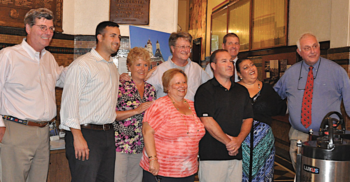 Gloucester Mayor Sefatia Romeo Theken and the Gloucester City Council also honored Sanfilippo for her many years of devoted service to the city and its fishing community and for protecting the oceans during a ceremony at Gloucester City Hall on Aug. 9.  And they saluted her for being named to the Boston Seafood Hall of Fame.  From left front, councilors Paul Lundberg, Joseph Orlando, Valerie Gilman, Sanfilippo, council vice-president Steven LeBlanc, Mayor Theken, and council president Joseph Ciolino.  From left back, councilors Scott Memhard and James O'Hara.  (Susan Pollack photos)