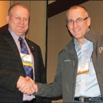 Bill Dewey, right, of Taylor Shellfish is presented this year's Joseph P. McCraren Award for Outstanding Contributions in Promoting the Growth of Aquaculture from National Aquaculture Association (NAA) President Mike Freeze. (Rick Martin photo)